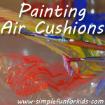 Painting air cushions with a toddler to explore a new painting surface!