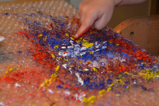 A really cool bubble wrap painting project for all ages that even a toddler can do completely on his own!