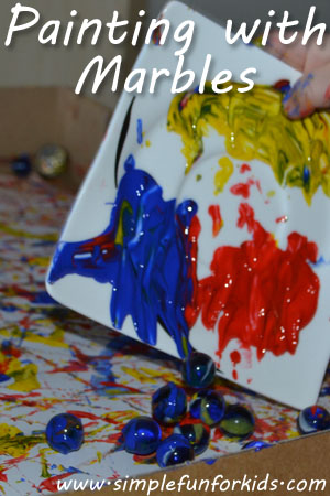 Painting with marbles - an art idea for toddlers and up that's a bit messy but great fun, and the results are lovely!