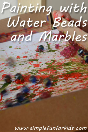 Painting with water beads and marbles - exploring the contrast between hard and soft while creating a lovely painting!
