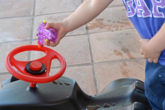 Spraying her Bobby Car.