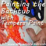 Painting the bathtub for a different art experience and as a way to contain the mess.