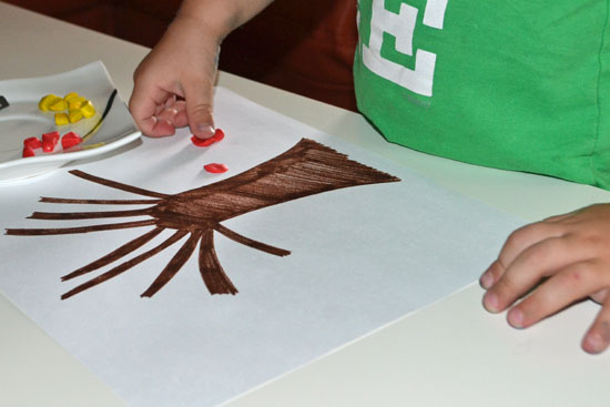 Simple fall tree craft with kid-made clay leaves.