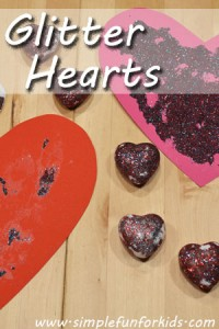 We glitterized a few hearts with a really simple technique that contained most of the glitter!