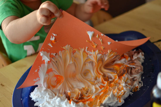 Use shaving cream and liquid watercolors to make Marbled Pumpkins and decorate for fall!