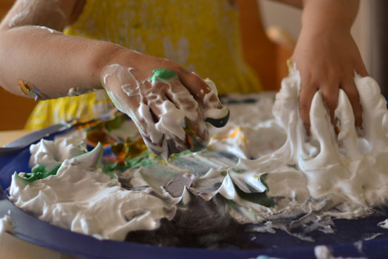 Extending a craft E loves with free exploration of shaving cream and liquid watercolors..
