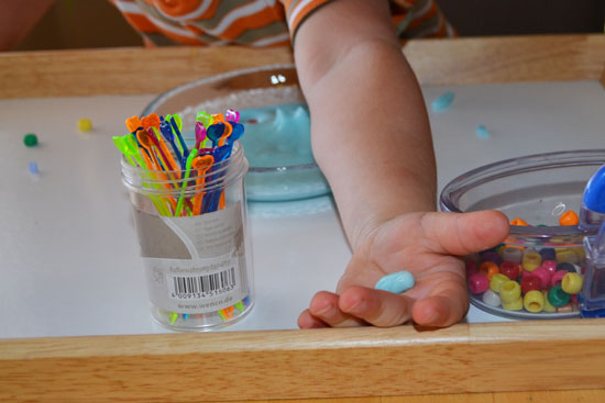 Low mess invitation to play with slime for older toddlers and up.