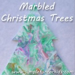 Make quick and simple marbled Christmas trees with colorful decorations using the shaving cream marbling technique!