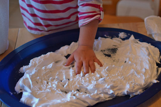 Have you tried using the shaving cream marbling technique with white paint? We made adorable Marbled Snowmen!