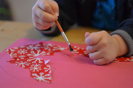 For Christmas, make a quick, simple, low mess wrapping paper collage shaped like a candy cane!