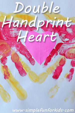 Make a super sweet Double Handprint Heart with your toddler for Valentine's Day!