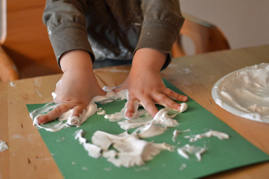 Use shaving cream puffy paint to make simple puffy snowmen decorations!