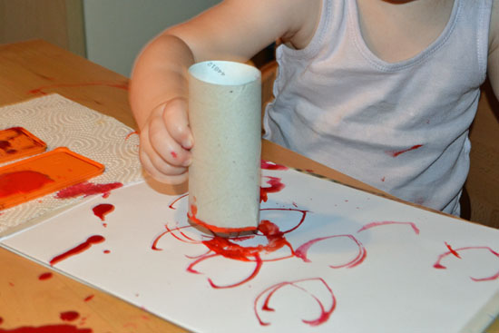 Make a simple heart shape from a cardboard roll and stamp some fun decorations!