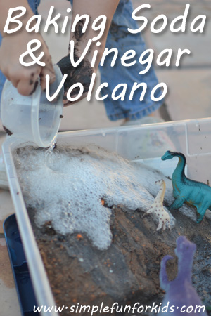 Baking soda and vinegar volcano from an old cloud dough sensory bin - lots of messy fun!