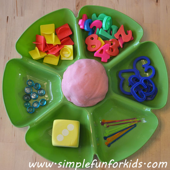 Combine basic math concepts with sensory play while exploring numbers with play dough.