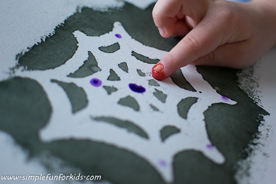 Make some quick and simple fingerprint spiders with your kids - perfect as a non-scary Halloween craft, or just because it's fun!