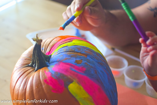 Pumpkin decoration: Make a fluorescent pumpkin with the blacklight on while painting - it looks SO COOL!