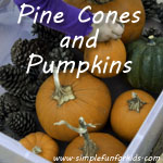 Fall gross motor play with pine cones and pumpkins!