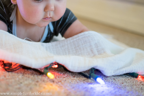 Baby Play with Christmas Lights: Beautiful and safe sensory play for tummy time!