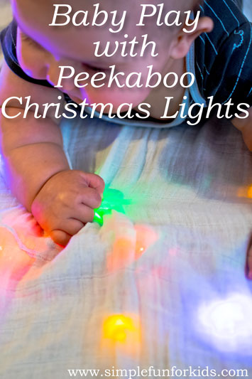 Baby Play with Christmas Lights