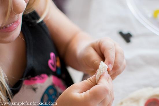 Winter Activities for Kids: Build a bottle cap snowman in play dough!