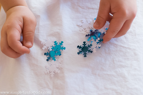Winter Activities for Kids: Build a bottle cap snowman in play dough!
