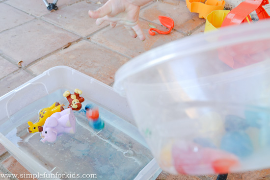 Simple sensory play for kids with colored ice and water in the water table!