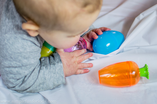 Preparing for baby's first Easter: Baby Play with Plastic Easter Eggs!