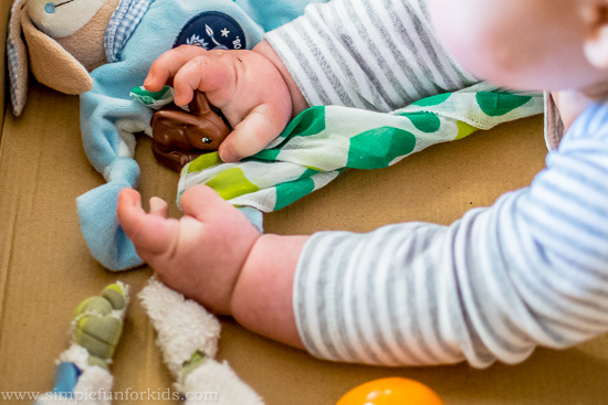 Baby can't sit up yet? Try a full body Easter sensory bin!