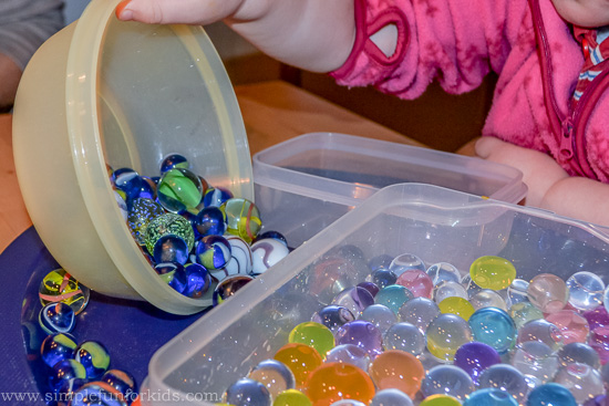 Sensory Play with Water Beads and Marbles: Exploring hard and soft and practicing fine motor skills!