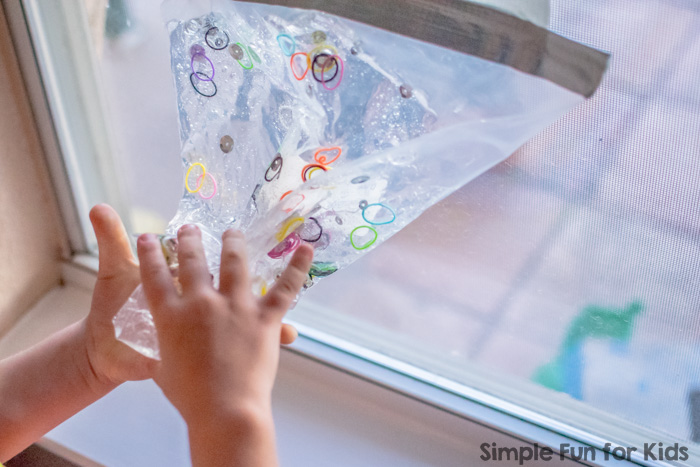 Simple Baby Safe Sensory Activity with Non-Baby Safe Items: Sensory Bag with Loom Bands, Glitter, and Sequins!