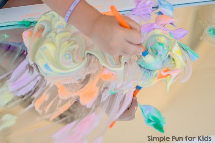 Sensory Art with Rainbow Shaving Cream Paint on the Mirror!