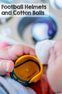 Quick and simple sensory play for toddlers with mini football helmets and cotton balls in a muffin tin!