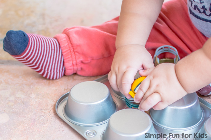Sensory Activities for Kids: Quick and simple toddler play with mini football helmets in a muffin tin!