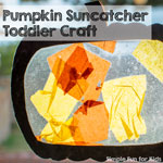My son's very first craft at 13 months: Pumpkin Suncatcher Toddler Craft!