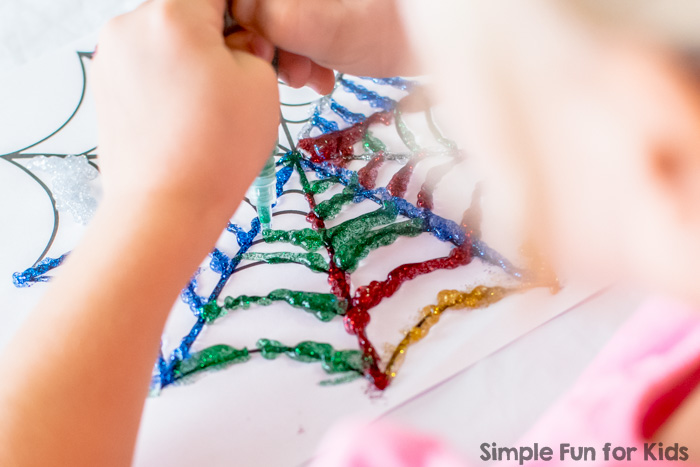 Super simple crafts for kids: We read Aaaarrgghh! Spider! and made glittery spider webs!