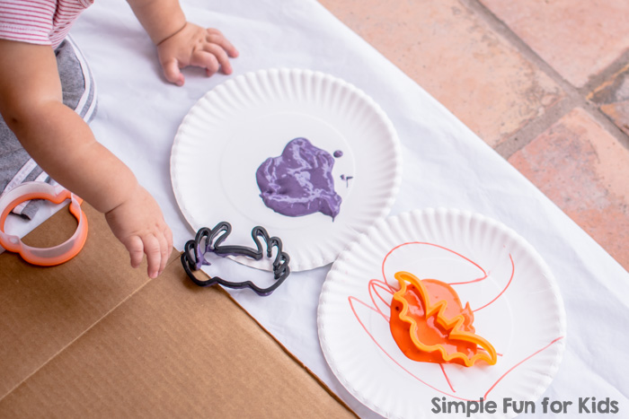Super fun Halloween Cookie Cutter Art for toddlers, using simple and colorful homemade, taste-safe paint!