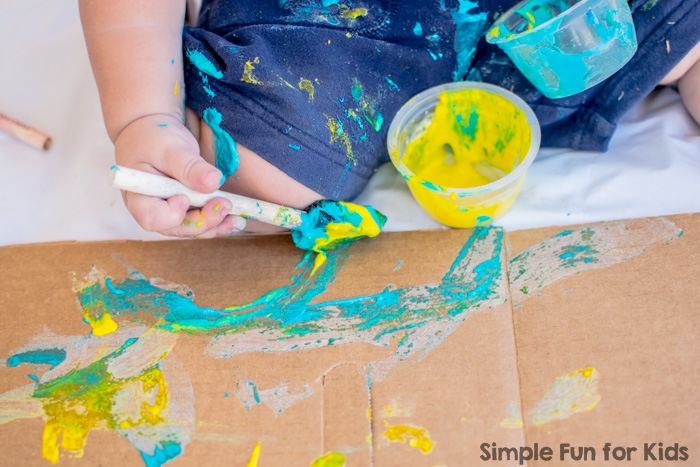 My toddler's first art project with super simple, taste-safe, and vibrant homemade flour paint!