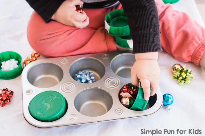 This time, my toddler found a Christmas surprise in a muffin tin! The set up was quick and simple, but it allowed for lots of fun sensory play and learning!