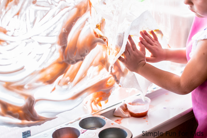 This was AWESOME! We'd wanted to try painting on shaving cream on a window for years, and when we finally did it, it was super fun! Art and sensory all rolled into one, and really easy to clean up, too!