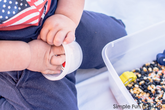 Sensory Activities for Toddlers: Does your toddler love discovering new materials? Try a simple transportation sensory bin that's quick and easy to set up and offers so much to explore!