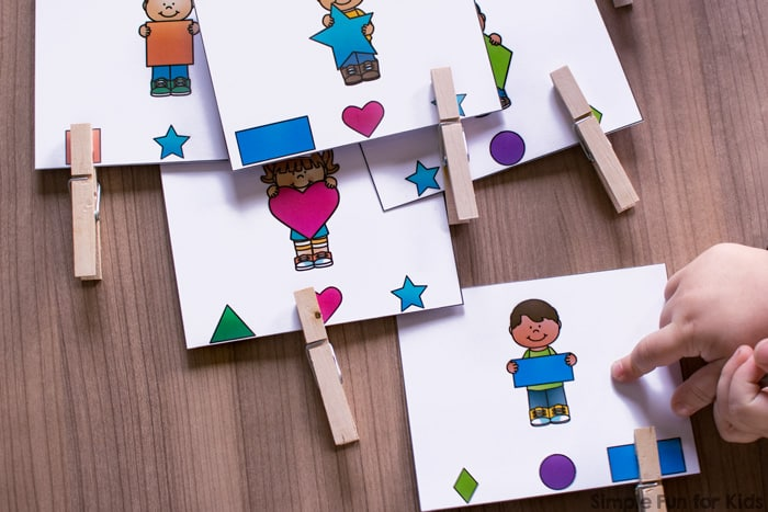 Is your toddler or preschooler learning his or her shapes? Get some practice AND some fine motor practice in with these cute printable Shape Matching Clip Cards! Includes triangle, square, star, circle, rectangle, oval, heart, and diamond.