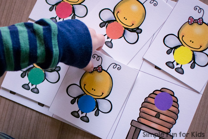 Help your toddlers and preschoolers practice their colors with this cute printable Honey Bee Color Matching Game! Put the bees in rainbow colors in their matching beehive.