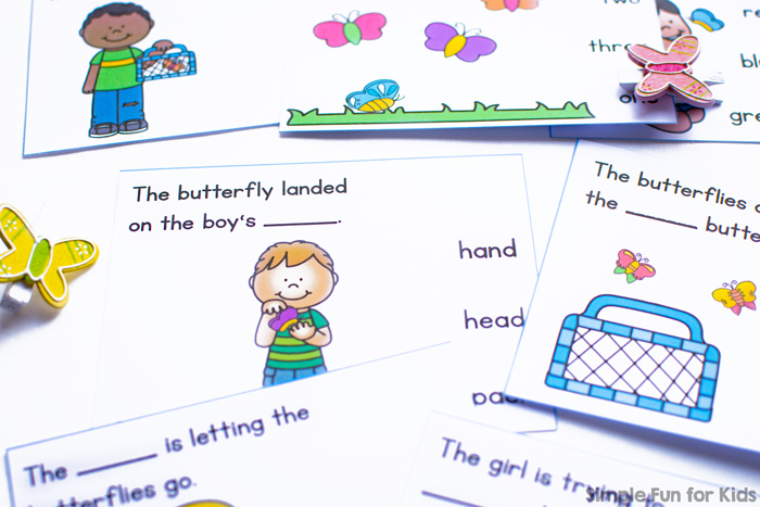 Practice reading and fine motor skills with these cute printable Catching Butterflies Fill in the Blank Clip Cards for kindergarteners and first graders.