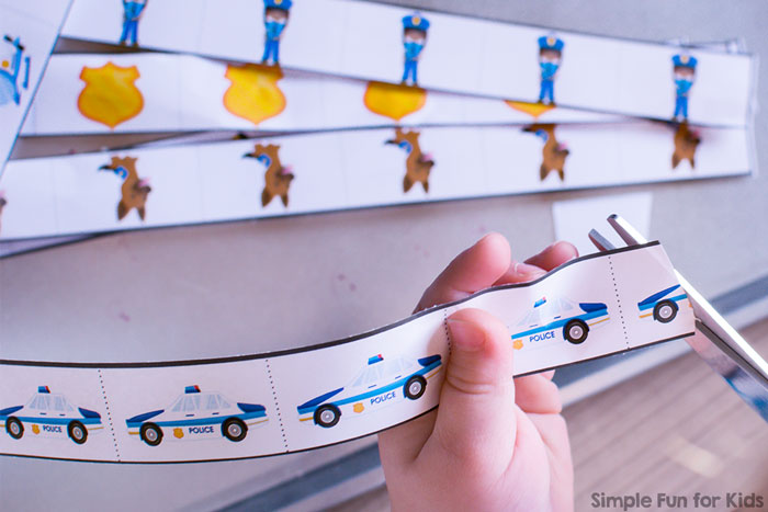 Practice fine motor and scissor skills with these cute printable Police Snip and Sort for Toddlers!