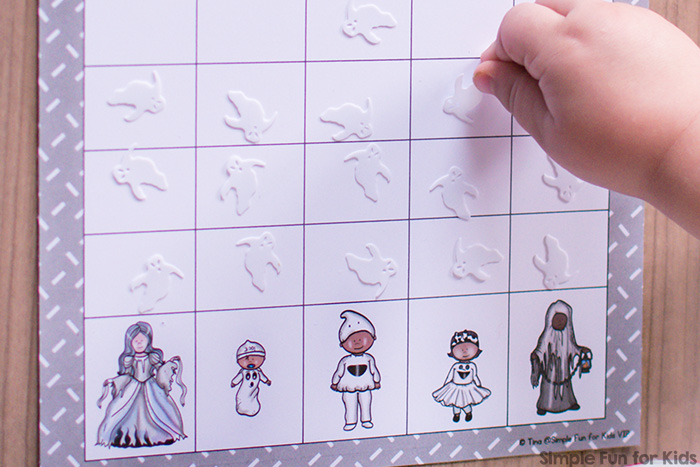 Practice 1:1 correspondence and counting and learn about predictions and basic chance with this cute printable Ghost Family Graphing Game! Preschoolers love it :) {Day 4 of the 7 Days of Halloween Printables for Kids.}