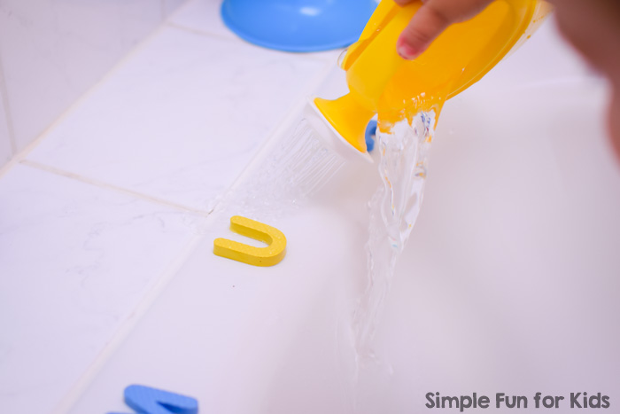 Super simple non-messy sensory literacy activity in the bathtub: Washing Away Foam Letters, perfect for toddlers and preschoolers.