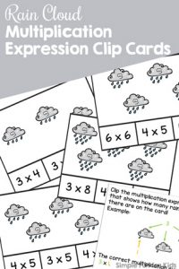 Enjoy this cute printable introduction to multiplication with elementary students in second grade: Rain Cloud Multiplication Expression Clip Cards work on fine motor skill and math concepts at the same time.