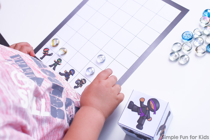 Counting, graphing, taking turns, rolling a die, and more: This simple cute printable Ninja Graphing Game works on many skills and is just plain fun for both my preschooler and elementary student.
