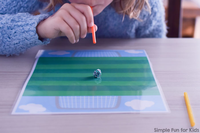 Fun oral motor exercise for solo play or with a partner: Straw Soccer Game! Includes a printable soccer pitch to play on.